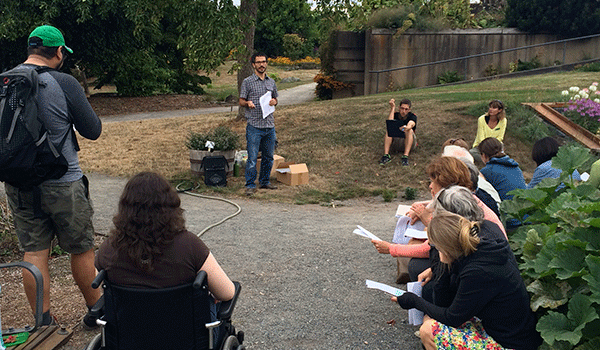 Workshop participants learn about waterwise gardening in the Food Garden with instructor Dr. Jose Celedon.