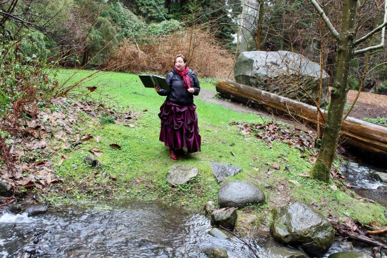 Celeste Snowber reading her poetry in a clearing