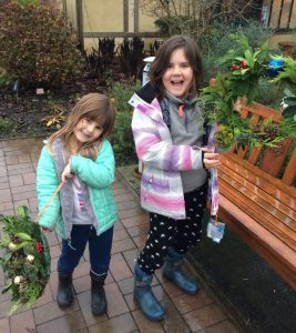 Children showcasing their wreaths