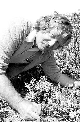 Jim McPhail posing with plants in the Garden